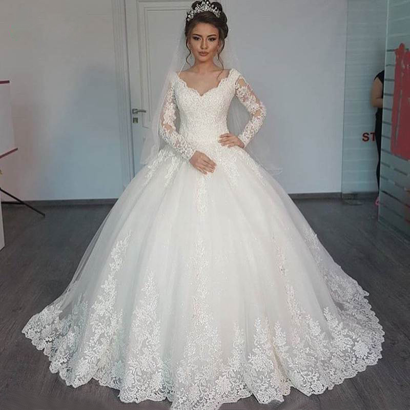 Gorgeous Sheer Ball Gown Wedding Dresses 2017 Puffy Lace Beaded Applique White Long Sleeve Arab Wedding Gowns robe de mariage