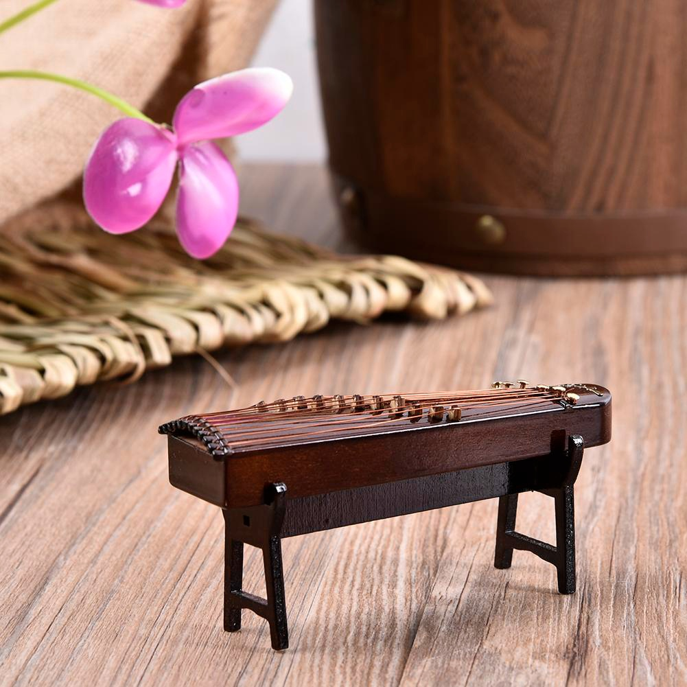 Image 5 - Hot Wooden  Mini Musical Instrument Handmade Miniature Guzheng Model Ornaments Commemorative Gifts 10cm-in Figurines & Miniatures from Home & Garden