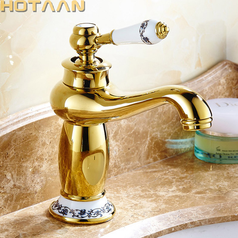 Robinet de lavabo de luxe robinet moderne robinet de salle de bain finition or robinet d'évier de bassin en laiton chaud et froid poignée unique avec robinets en céramique