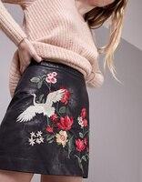 2017 Printemps mode femme noir faux jupe en cuir avec fleurs brodé Short Mini jupes