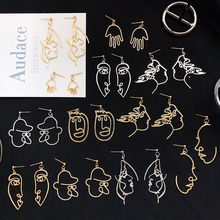 Trend Abstract Art Drop Earrings Gold Color Hand Palm Face Crystal Dangle Earrings Girls Fashion Statement Earrings For Women(China)