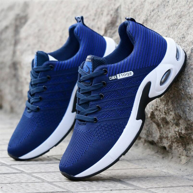 Spring and autumn new wild breathable tide casual fashion men's shoes movement men's shoes fly woven Sneakers air cushion shoes