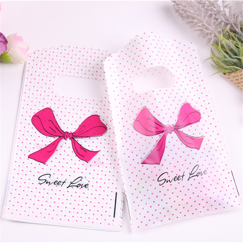New Design Wholesale 50pcs/lot 9*15cm Lovely Small Gift Plastic Bags With Bow Favor Birthday Packaging