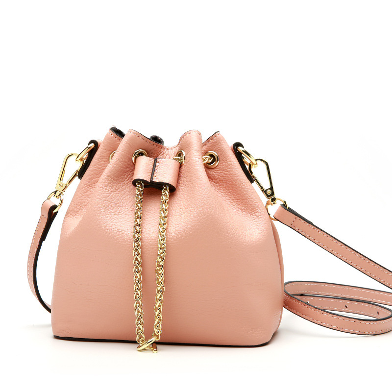 The small and exquisite women messenger bags add color to the romantic and elegant life. The new trend cowhide bucket bagThe small and exquisite women messenger bags add color to the romantic and elegant life. The new trend cowhide bucket bag