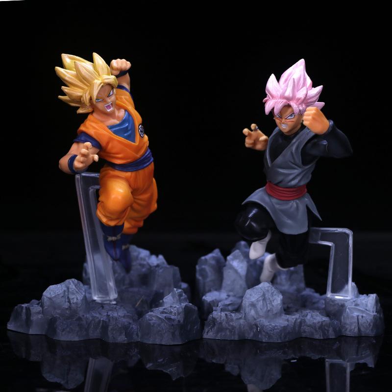 Two Goku Figures