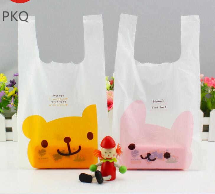 100pcs 5 sizes 30x54x14cm Large Cute cartoon lattice plastic bag vest food  packaging bag supermarket shopping d3aa71e3ce