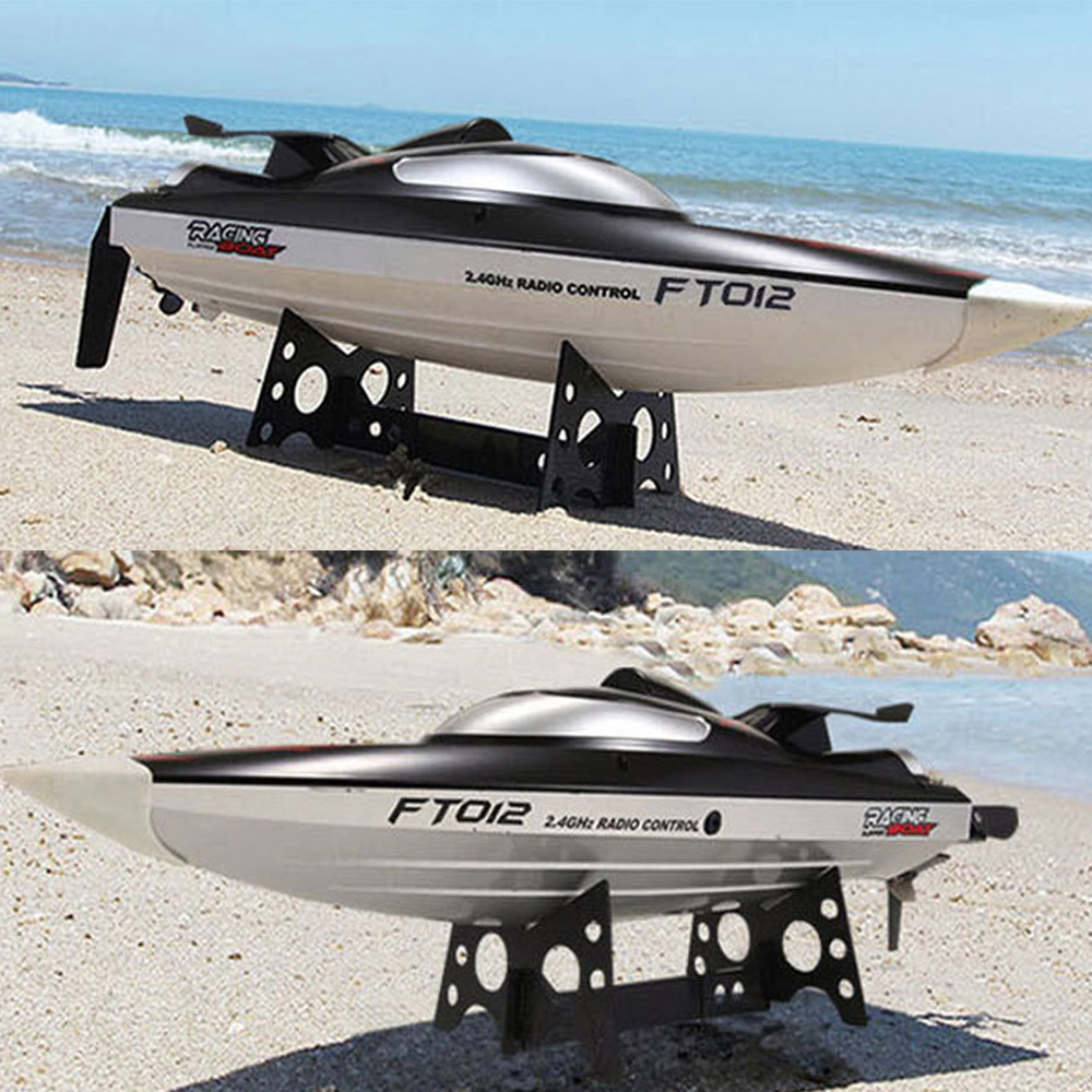 Hot sale FT012 2.4G Brushless RC Remote Control Racing Boat Model Speedboat High Speed 45km/h RC Boat with Water Cooling Systerm feilun ft009 2 4g 4ch water cooling high speed racing rc remote control boat