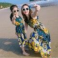Madre e hija de ropa de las mujeres vestidos para la playa vestido de tirantes chicas de la vendimia sin mangas vestido largo del verano para hombre pantalones cortos de niños camiseta