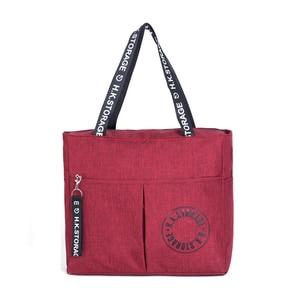 Image 1 - Waterproof Big Travel Bag Foldable Women Duffle Bag Travel Organizer Overnigh Bags Portable Shoulder Weekend Bags Business Tote