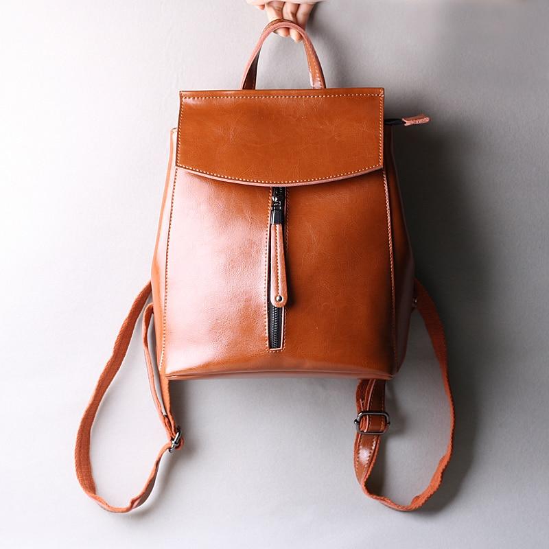 Nouveauté femmes sac à dos en cuir véritable femmes sacs designer décontracté réel sac à dos en cuir pour ordinateur portable solide femme trave sac