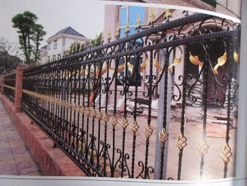 Wrought iron fencing ornate wrought iron fence in black with unique posts and a solid gate