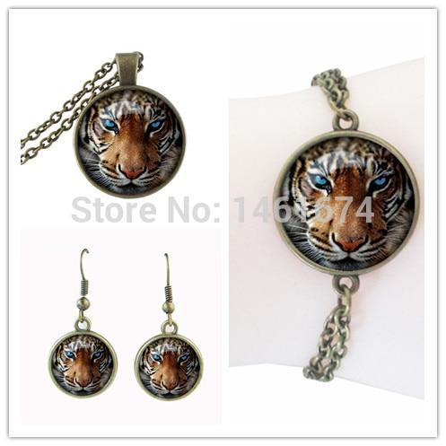 987d8ed59c643 Conjuntos de jóias de tigre Rei da Montanha forte animal bronze cabochon de  vidro conjunto de jóias personalidade presente da jóia por atacado