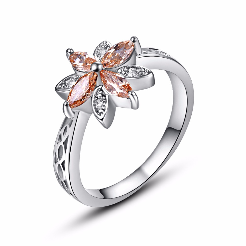 stock image gold wedding rings orange ribbon near white background image orange wedding rings Gold wedding rings orange ribbon