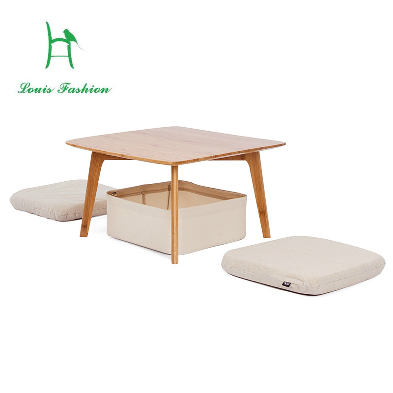 Asian-style table and floor cushions – buy images – StockFood