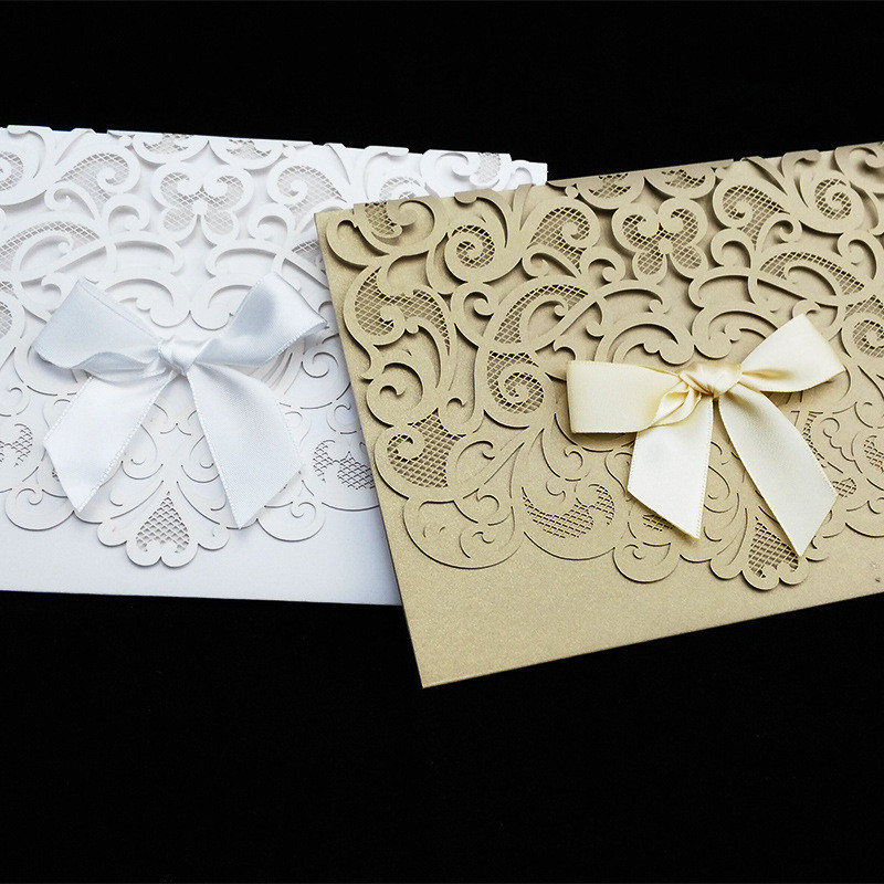 50pcspack luxurious elegant wedding invitation cards hollow 50pcspack luxurious elegant wedding invitation cards hollow flower ribbon bow birthday party card greeting cards with envelope in cards invitations from stopboris Gallery