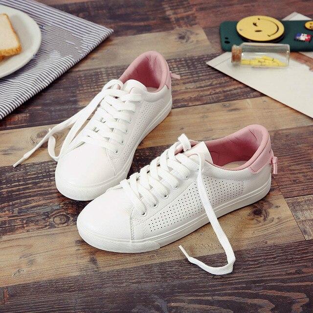 HUANQIU Kadın beyaz ayakkabı Delikli Deri Ünlü Marka Kadın rahat ayakkabılar Kuyrukları 2017 Yeni Moda Eğlence Flats Nefes