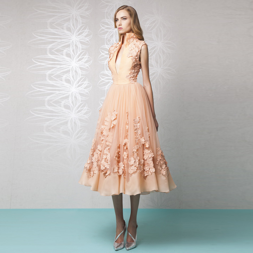 Peach colored tea length dresses