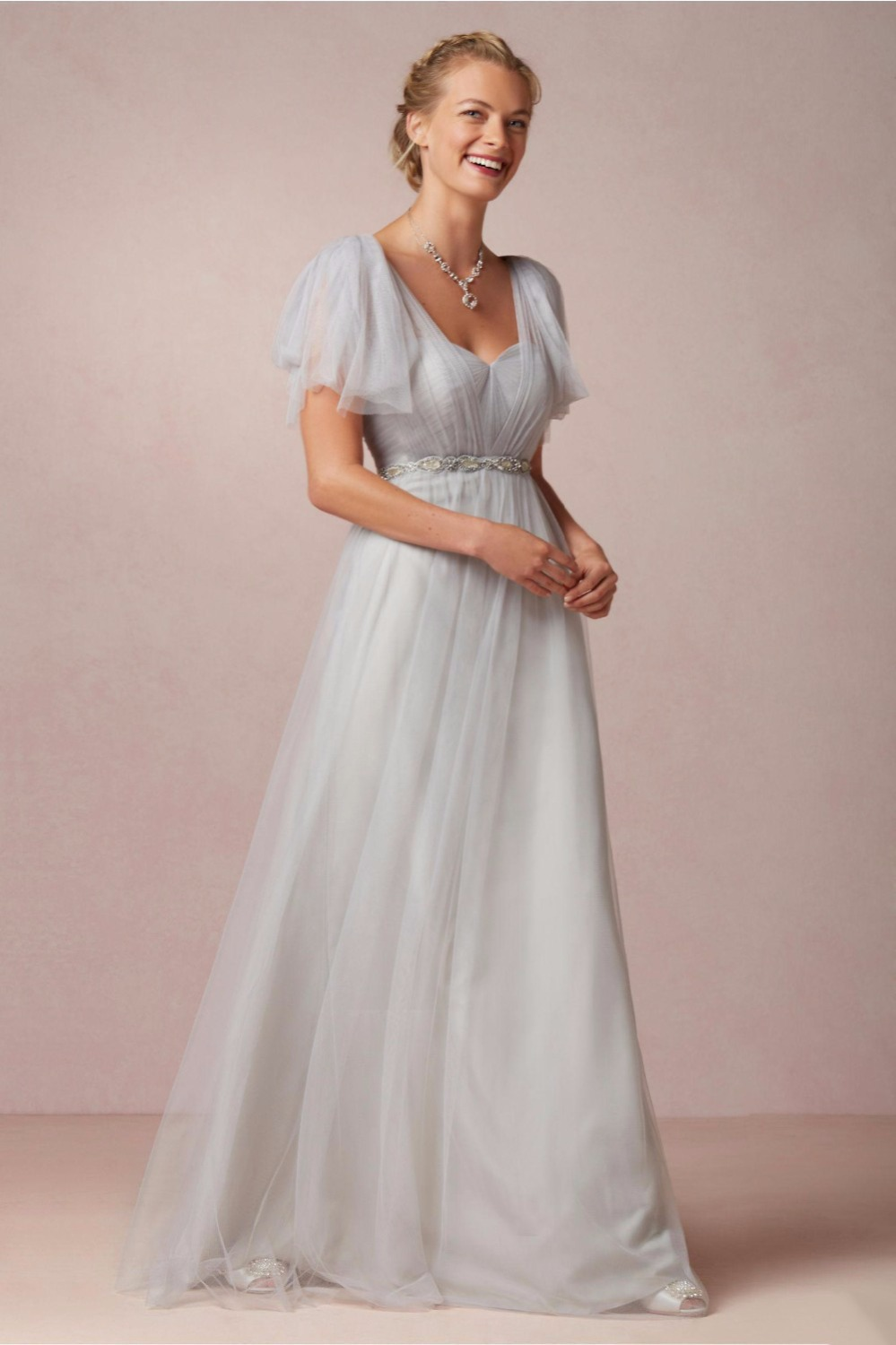 wedding dress with one shoulder and organza and silver
