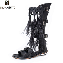 Prova Perfetto Summer Gladiator Sandals Feather Tassel Solid Long Sandals Boots Women Genuine Leather Rivets Buckle Shoes Flats