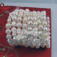 New Free Shipping A586# Grade AA.Natural Fresh Water Pearl Bracelet.Size:7 8mm.White Color. 8Rows 1pcs/lot