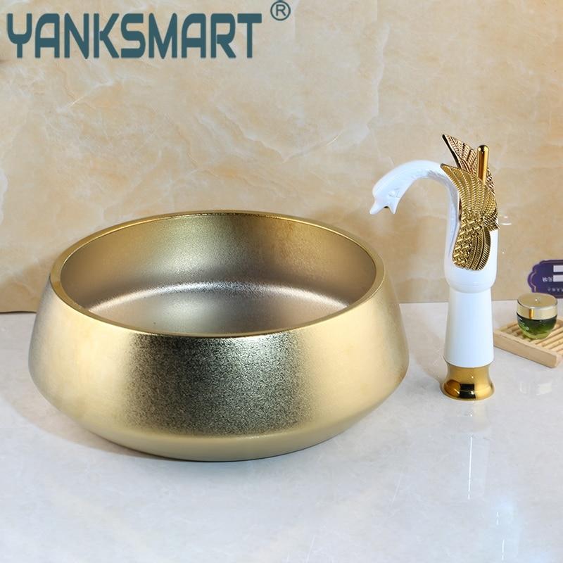 Ensemble de robinet de bassin de cygne de salle de bains éviers de cuve bassins en céramique évier de bassin en or poli robinet ensemble de robinet en céramique dorée