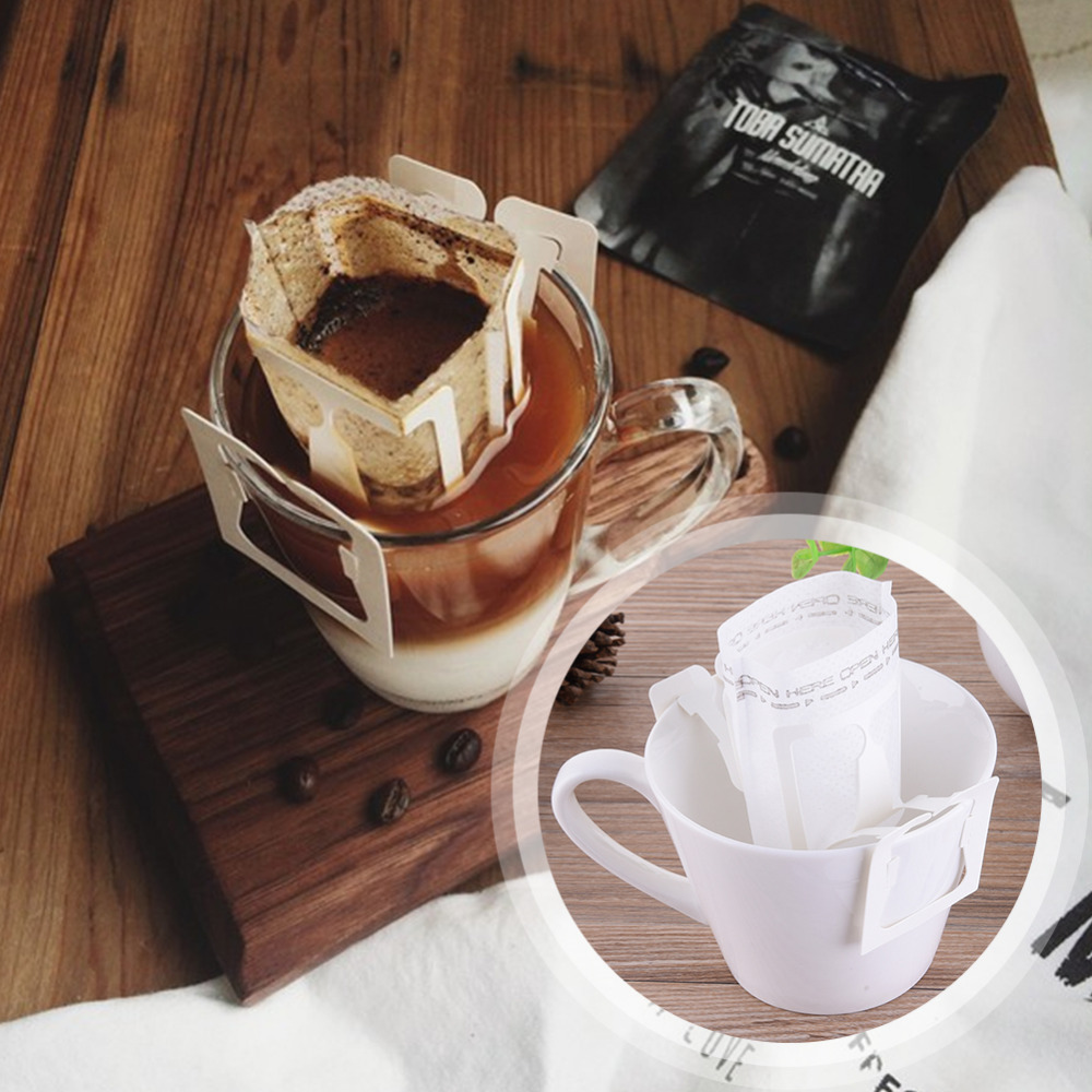 50Pcs / Pack Drip Coffee Filter Bag Portable Hanging Ear Style Coffee Filters Paper Home Office Travel Brew Coffee Bolsas de te50Pcs / Pack Drip Coffee Filter Bag Portable Hanging Ear Style Coffee Filters Paper Home Office Travel Brew Coffee Bolsas de te