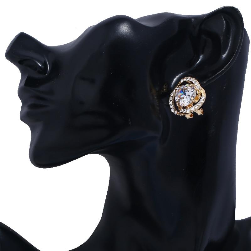 WNGMNGL Hot Sale Stud Earrings Classic Elegant Luxurious Zircon Hollow Flower Earrings For Woman 2018 New Female Fashion Jewelry in Stud Earrings from Jewelry Accessories