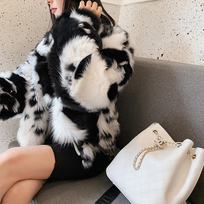 Fur coat with black-and-white Tuscany outline and skinny anti-season fur coat
