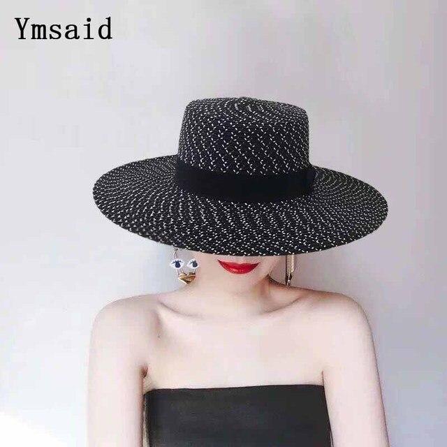 a087a8c00b3d7 2018 été nouveau femmes élégant noir et blanc plat chapeau de soleil arc  Chapeaux de paille