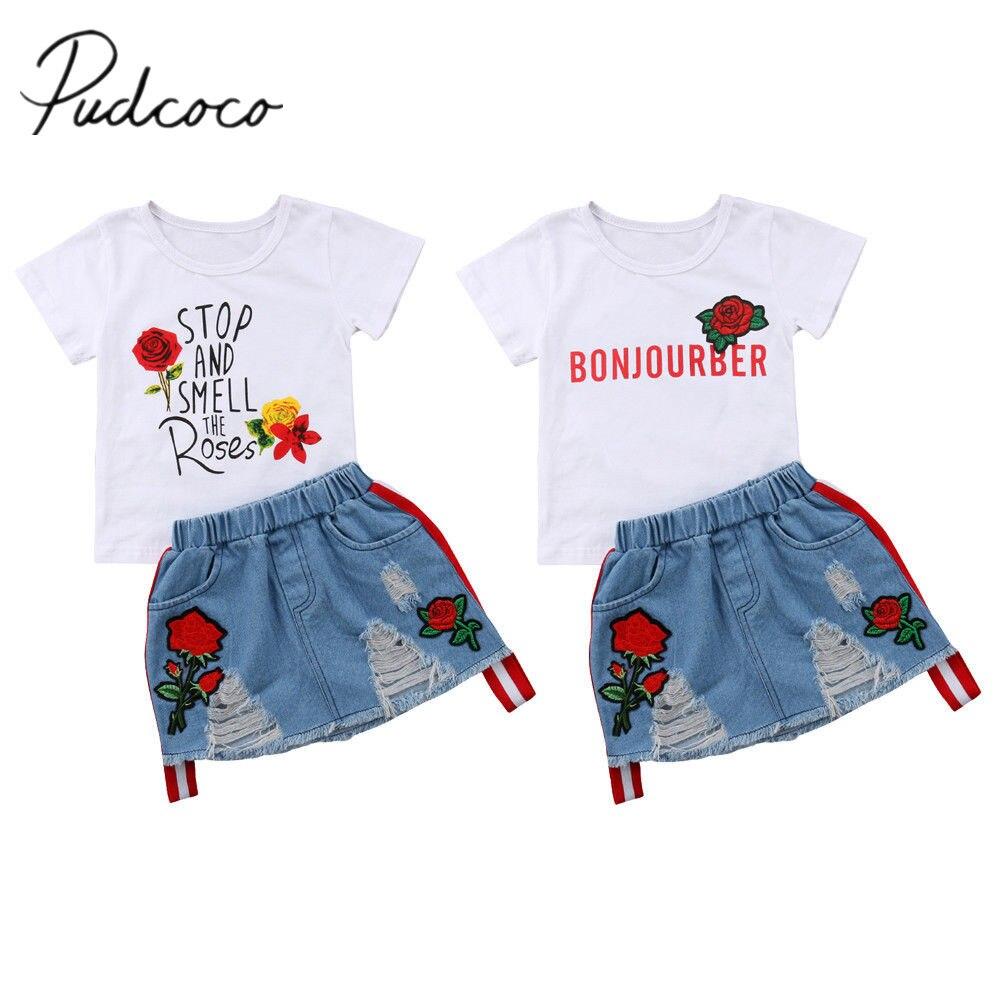 b1e93a3c1 2018 a estrenar nueva ropa de verano para niños y niñas de manga corta  Camiseta Floral Tops + bordado flor agujero falda de mezclilla 2 piezas  conjunto