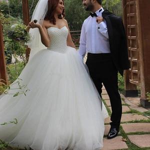 Image 2 - ノースリーブチュールふわふわ花嫁のウェディングドレスホワイトアイボリー豪華なビーズ王女のウェディングドレス