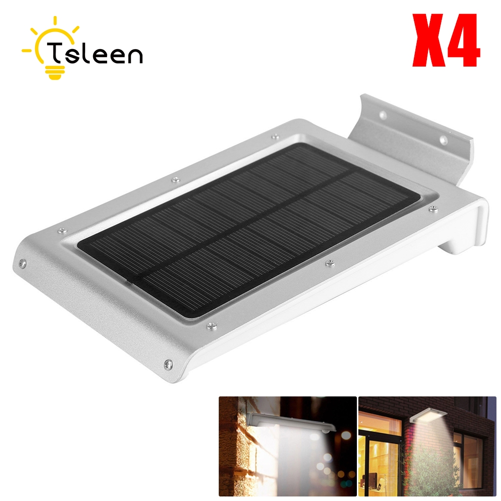 все цены на TSLEEN 4Pcs 46 LED Solar Powered Outdoor Light Waterproof PIR Motion Sensor LED Solar Lamp Solar Led Garden Path Light онлайн