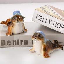 Premium Ceramic Gift Christmas Dolphin Model Cute Blue Hat Fur Seal Sand Fish Prop ceramic for Home decoration