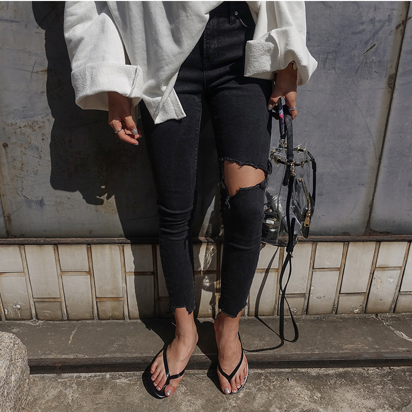 Korean Version Of The Small Feet Tight Stretch Nine Pants Pants Knees Irregular Fuzzy Black Hole Jeans 7300#