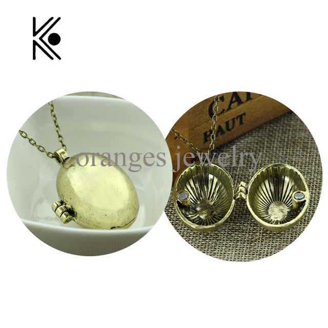 Cute Fantastic beasts Dinosaur eggs can open Pendent necklace Magic