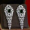 Hotsale joyería de Lujo del oro circón cúbico micro pavimentada boda palacio borla brillante cuelga los pendientes para las mujeres