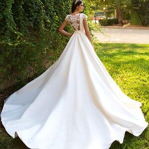 Image 2 - Nieuwe Aanbieding Korte Mouwen Bridal Jurken Kralen Applicaties Illusion Terug Frankrijk Satijn Bruidsjurken Vestidos De Boda