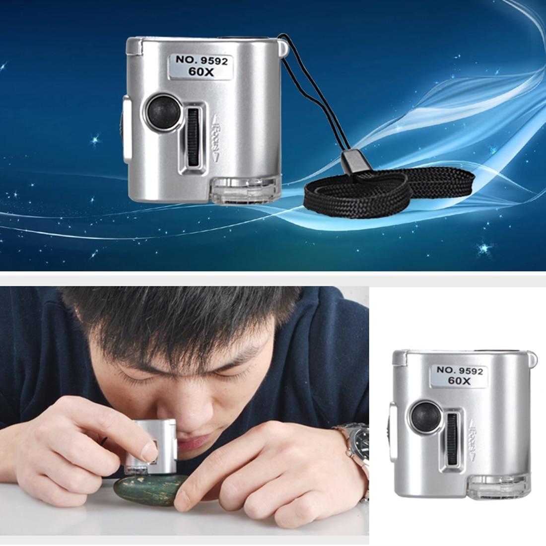 1pc nuevo Mini 60X microscopio de bolsillo de la lupa de vidrio LED UV de luz Mini-microscopio Amplificador de joyas