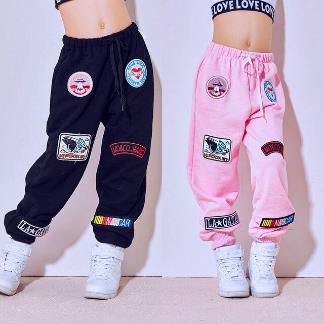 Yeni moda siyah pembe caz dans pantolon çocuk Hip Hop pantolon sokak dans Ds kostüm pantolon gevşek rahat Sweatpants DL2469