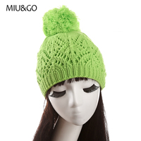 MIU GO Cable Knitting Beanie Geometric Hollow Patterned Hat With Fluffy Pom Pom For Women And