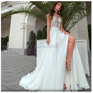 Image 2 - Side Slit A Line Boho Wedding Dresses Sexy Sheer High Neck Short Sleeves Chic Lace Appliques Chiffon Bridal Gowns Buttons Back