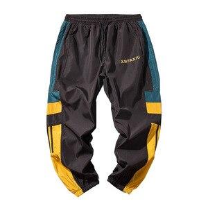Image 3 - Joggers Sweatpants Men Casual Striped Pants Fashion Loose Track Pants Men Sweat Pants Sports Japanese Streetwear White Black
