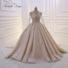 تصميم أماندا برقبة عالية وأكمام طويلة مطرزة بالكريستال لامع شفاف فستان زفاف
