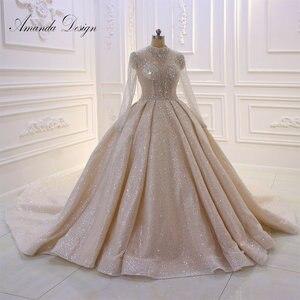 Image 1 - Amanda Design High Neck Long Sleeve Luxury Crystal Beading Shiny See Through Wedding Dress