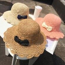 2017 primavera y el verano la moda pequeño arco sombrero de paja Playa Sol  femenina sombrero de verano viajan a lo largo Fold so. a8e522ded77