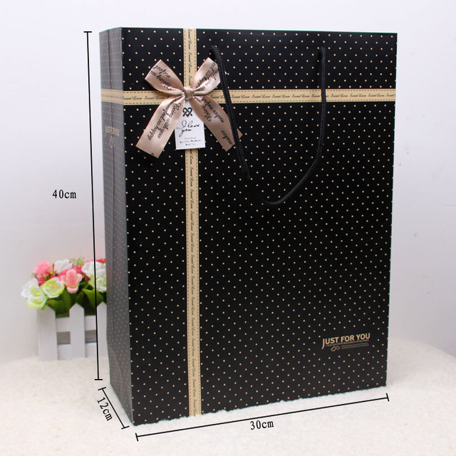 New white card vertical version spots gift bag laminating paper bags wholesale