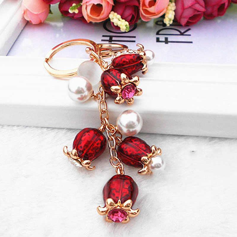 RE cristal Diamante de imitación regalo aleación llavero mujer bolso coche llavero tulipán cuentas joyería moda regalo baratija J2520