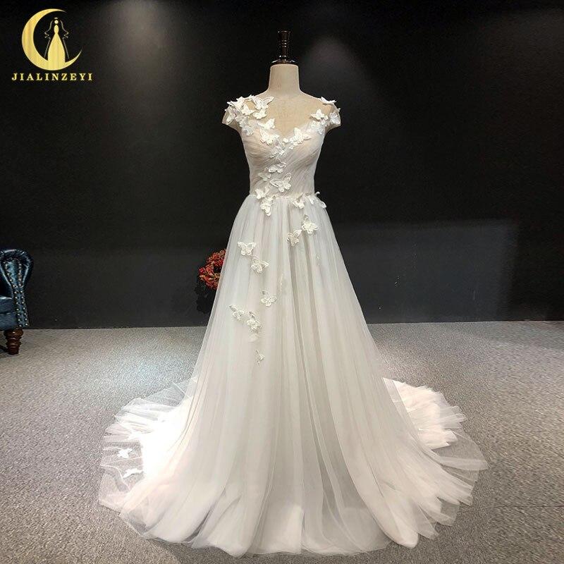 JIALINZEYI Real image Sexy manches courtes avec papillon V retour robes de mariée de mariée robe de mariée 2018
