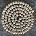 Comercio al por mayor Tibetana Budista 108 Granos de mala de Alta Densidad Xingyue Bodhi Semilla Cuentas de Cilindro de Madera Natural Para DIY Joyería OM