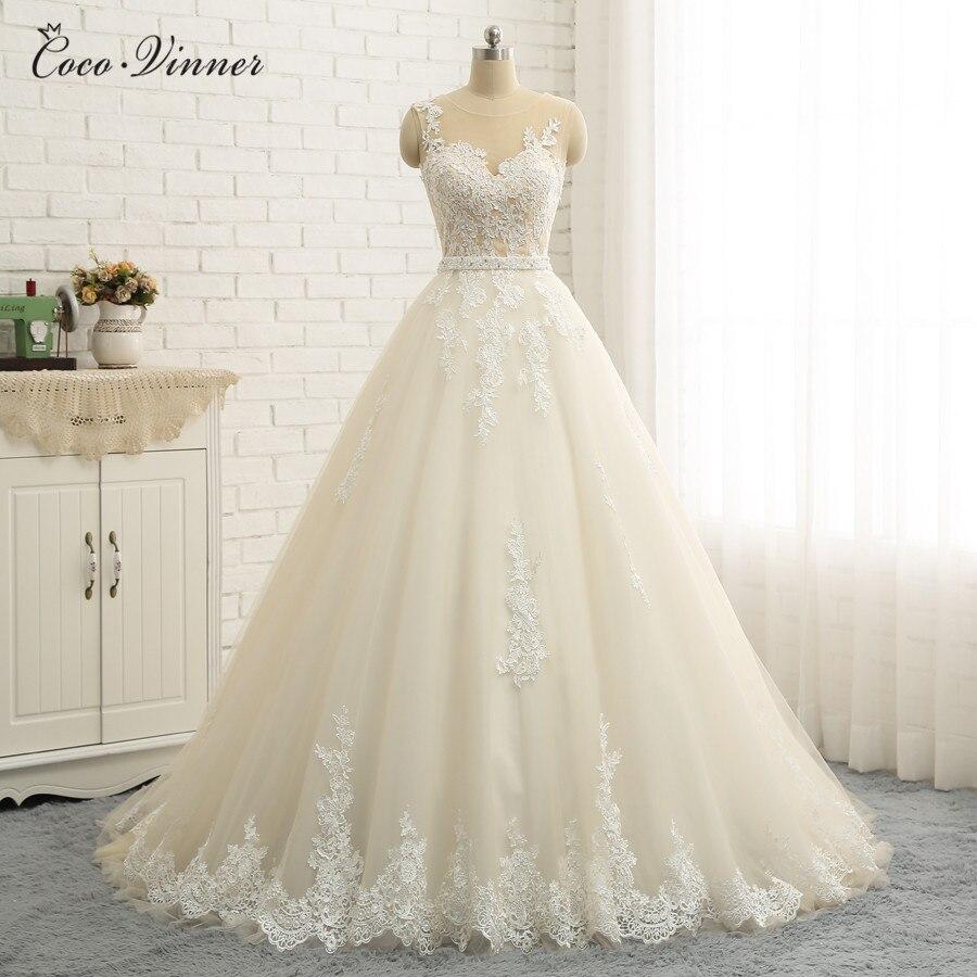 Sexy Illusion Back Embroidery Appliques Quality A Line Wedding Dresses Dubai Sleeveless Plus Size Pearl Sash Arab Wedding Dress
